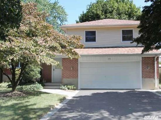 Split Level Home W/ Spacious Rooms,  Vaulted Ceiling,  Skylight,  Gleaming Hardwood Floors,  2 Car Garage. Great Mid Block Location! Short Walk To  Willits Elem And Thompson Middle Schools. Syosset Library A Few Short Blocks Away. Convenient To Shopping,  Schools,  Restaurants,  Highways,  Train And All The Area Has To Offer!