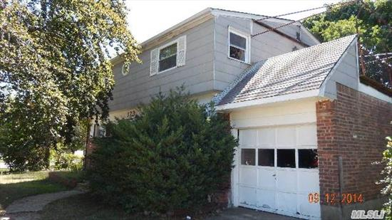 This Home In This Prime Plainview Location W/ Bethpage Schools, Is In Need Of Some Tlc Is Being Sold As Is.  It Features 5 Br's,  2 Full Baths,  Eik,  Hardwood Floors In Lr & Dr,  Updated Windows Upstairs,  Updated Electric,  Real Hardwood Flooring In Finished Basement.1906 Interior Sq. Ft,  Let Your Imagination Run Wild! All Info Deemed Accurate Must Be Verified By Buyer