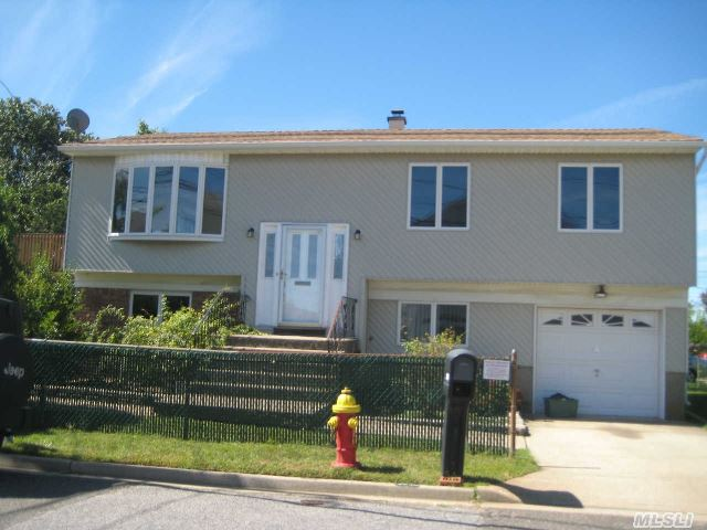 Super Wide Line High Ranch. Waterview. Fenced 2 Car Driveway. House Needs Tlc. Don't Miss It.