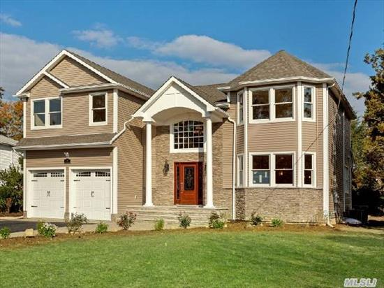 Luxurious New Colonial W Open Floor Plan,  2 Story Entry. Dream Kitchen W/Ss Appliances,  Granite & Ctr Island. Opulent Master Suite W 2 W-I-C,  Mbth W Jetted Tub & Sep Shower Large Guest/Nanny Suite On 1st Floor. Custom Millwork  & 9' Ceilings. Cntrl Vac,  Full Basement W 9' Ceilings /Lrg Windows & Ose. Every Amenity!  Incredible Location!  Walk To Train!   Syosset Schools.