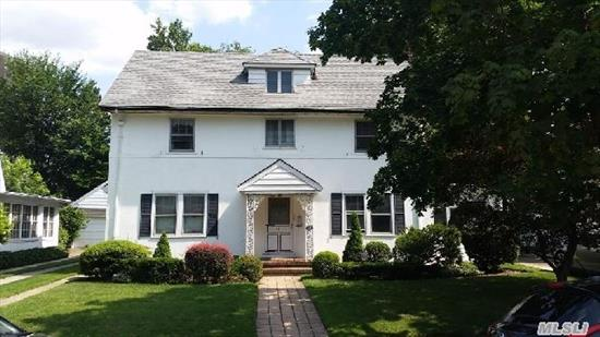Amazing Opportunity To Own A Classic 1920'S Center Hall Colonial On One Of The Most Sought After Blocks In Kew Gardens! Set On One Of The Largest Properties In The Area (Full 60X100 Lot Size),  This Beautiful Home Offers Grand Formal Rooms,  A Large Living Room W/Fireplace,  Side Family Room,  Banquet Formal Dining,  'Art-Deco' Eat In Kitchen,  Full Finished Basement. Hurry In!