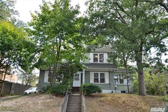 Rare Find... True Legal 2 Family.  True Taxes $7504   Large Rooms With 9 Foot Ceilings.  Living Room With Fireplace. Hardwood Floors Throughout.  First Floor: Lr,  Dr/2 Bedrooms,  Eat In Kitchen,  2 Brs,  Full Bath.  Second Floor: Lr,  Eat In Kitchen,  2 Brs,  Full Bath.   Natural Gas.  Separate 2 Car Garage.  Walk To Village & Lirr.