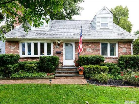 Pristine 4 Bedroom,  2 Bath Cape. New Kitchen,  Granite Counters,  Stainless Steel Appliances,  Hardwood Floors Throughout,  Cac,  Wood Burning Fireplace,  Upgraded Electric,  Large Deck,  Detached 1 Car Garage. New Driveway With Belgian Blocks. 1/2 Mile To Lirr!
