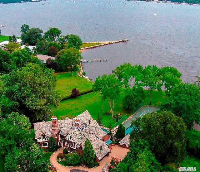 Not All Waterfront Property Is Created Equal! Most Prestigious Location W/ Private Beach. Enjoy Sweeping Views Of Manhasset Bay While Relaxing By Pool Or Playing Tennis. Distinguished 3 Story English Manor, Meticulously Maintained, Thoughtfully Updated. Grand Scale Entertaining Rooms, Boasting Finest Of Old World Charm And Modern Amenities. 210 Ft Of Direct H20Front!