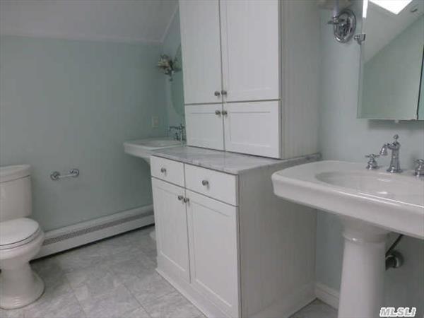 Master Bath linen tower & Double Sinks