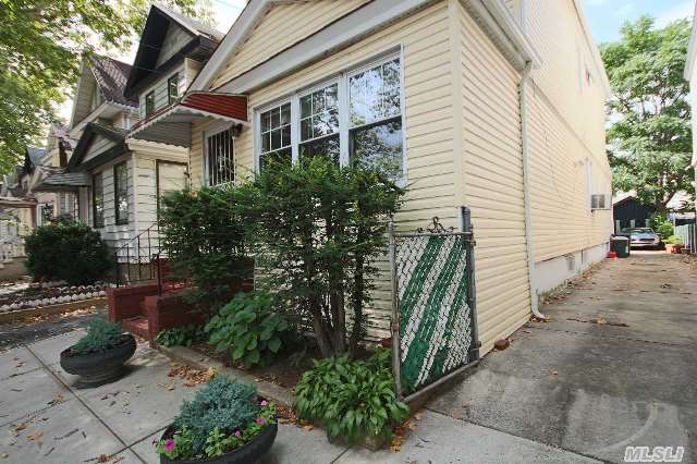 Two Family,  Fully Detached Home Used As One Family,  Driveway For 2 Cars,  Backyard With Room To Park 2 More Cars,  3 Bedrooms,  1 Full Bath,  2 Half Baths,  Semi Finished Basement,  Renovated,  New Or Nearly New Everything.  Near J And A Trains,  Buses,  Jamaica Ave