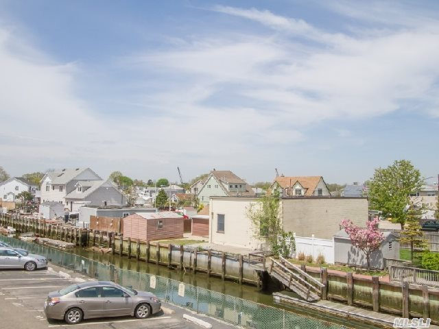 Large 2 Bdrm 2 Bath 2nd Floor Split Waterfront Unit With Plenty Of Storage. Hardwood Floors,  Large Living Room/Dining Room Combo,  Nice Size Kitchen W/Sliders To Terrace Overlooking The Canal. Large Master With Private Bath,  Attic Access. 3 Ac's. Great Unit!