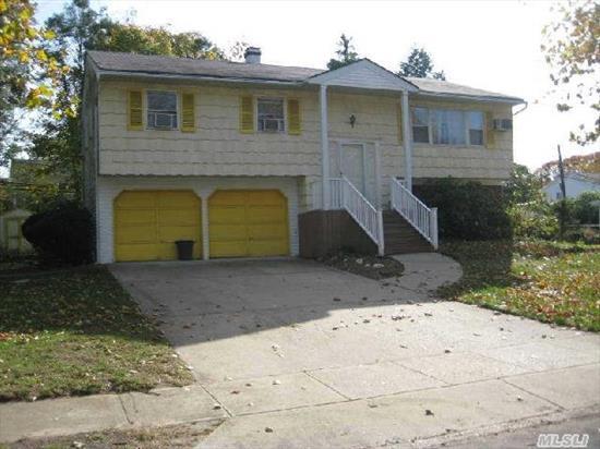 Wideline Hi-Ranch In Harborfields Sd #6. Quiet Street,  Flat Property,  2 Car Garage