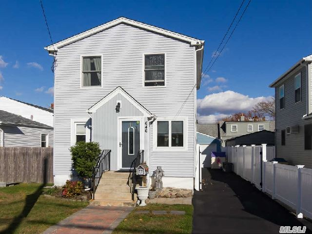 Updtd & Well Maintained Colonial In Village Of Lindenhurst. Priced Aggressively W/ Low Taxes.  Home Features & Recent Updates Inc: 2 Cac Units,  Upg Elec W/Generator Ready & Incl Generator W Sale,  Upd Heat System,  Security Camera System,  Pavers In Yd,  H/W Flrs,  Freshly Painted. Located Mid Blk.Great Curb Appeal & Lg 1.5 Det Garage.  Taxes W/Star Only $7, 780.18