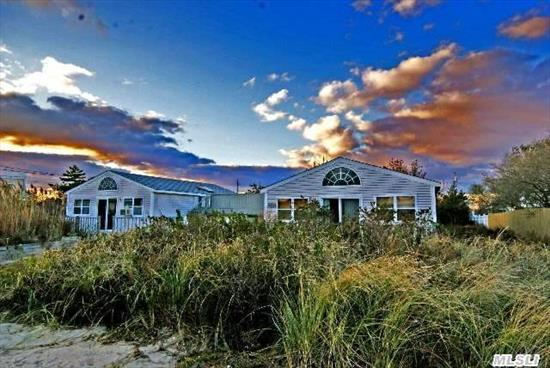 2 Cottages On 1/3 Of An Acre -- Mirror Image Cottages, Each 900 Sq Ft With 3 Bedrooms, Full Bath, Kitchen, Living Room & Individual South-Facing Decks. Over The 2-Car Garage Is Expansive 2nd-Story Decking & Wonderful Bay And Ocean Views. Tremendous New Construction Or Expansion Potential On This Expansive 140 X 100 Ft Lot.