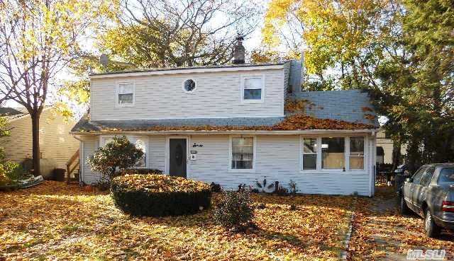 Bring Your Hammer. To This Double Dormered Cape In Island Trees School District.  Mid Block Location.  200 Amp Electrical Service.  Vinyl Replacement Windows Throughout.  2 Updated Bathrooms.  Home Needs Updating And Being Sold As Is