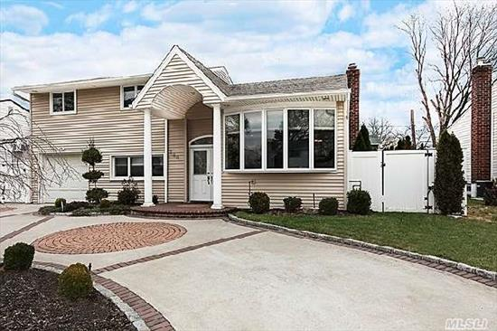 Completely And Exquisitely Renovated In 2009,  This 3 Bedroom,  2 Bathroom Split Level Home Includes A Custom Gourmet Kitchen Featuring Sleek,  Modern Cherry Cabinetry, Tiled Back Splash, Breakfast Bar & Top-Of-The-Line Stainless Steel Appliances.Updates Include The Roof,  Siding, Windows, Driveway, Fence, Electric, Heating,  Hot Water Heater, Bathrooms, Basement, Family Room, Stairs....