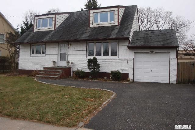 New Listing! North Syosset 4B/2Fb,  Dormered Cape On 81X130 Property With Garage + Two Car Driveway. Warm And Sun Filled Spacious Rooms. Eat In Kitchen,  Dr And Full Basement With Separate Entry. Two Bedrooms On First Floor With Full Bath And Two Bedrooms Upstairs With Full Bath. Village Elementary And Southwoods Middle School. Close To Lirr And Shopping. Freshly Painted