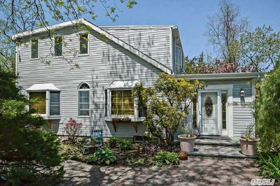 One Of A Kind Colonial On 1.11 Acre Lot In Harborfields Sd#6. Country Kitchen W/Sliding Door To Deck With Agp. Living Room W/Fplc. Den,  Updates Include: Kitchen,  Bathrooms,  Windows,  Siding,  Cac & More. Taxes W/Basic Star: $11060.31