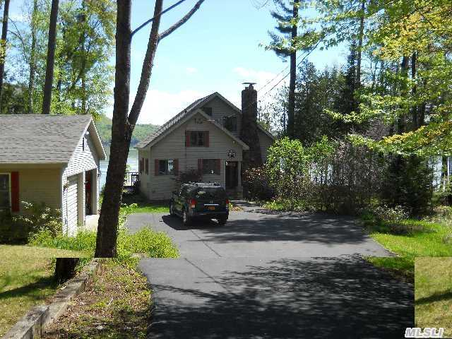 A Beautiful, All Year Round, 4 Bdrm Home On Lovely Lake George! Eik, Formal Dr, Lr With Fplc, Enjoy This Spectacular Sunroom W/ Stunning View Of The Lake. Huge 2 Car Detached Garage - Dock Your Boat In Your Own Covered Boat Slip, Private Beach, Quiet & Tranquil...Newly French Drains.