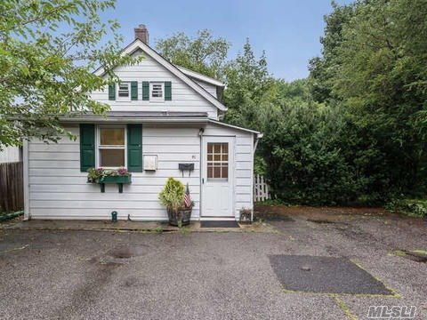 Renovated And Charming Cottage In A Quiet And Desirable Neighborhood On Picturesque Lot. New Eat In Kitchen With Quartz Counter-Top And Stainless Steel Appliances, New Bath, New Heating System, Hot Water Heater, Hardwood Floors And Built-Ins Throughout. Potential For Expansion.