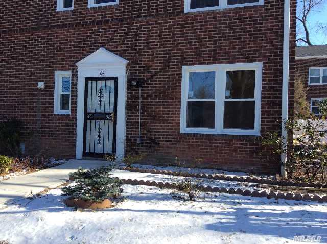 Lovely Corner Unit,  With Updated Kitchen And Bath...Hardwood Floors In Lr,  Foyer,  And Br.  Ceramic Tile Kitchen Floor,  New Windows,  Nice Sized Corner Yard. Carrying Charges Incl Electric And Heat.  Freshly Painted!