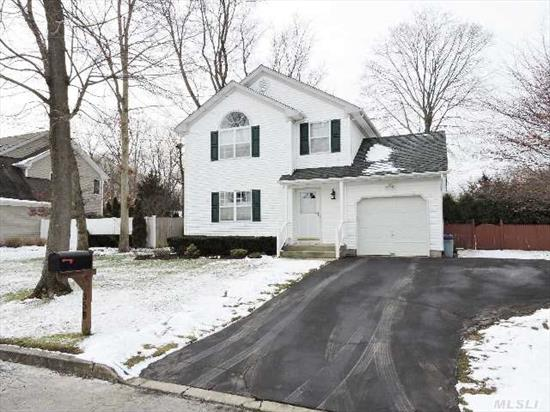 Move In Ready. Beautiful 3 Bedrooms 1.5 Bath Colonial Located In Smithtown School District. Features Huge Master Bedroom,  Rear Deck W/ Awning Off Eik. Full Basement,  Beautiful Landscaping,  Sprinklers & More!