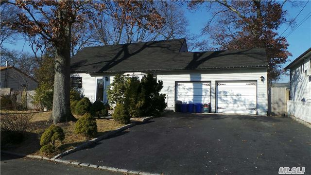 .Super Home On Quiet Street With Very Large Rooms. Plenty Of Room To Roam. Beautiful Floors Beautiful Floors Gas Heat New Roof, 2 Car Garage Converted To Great Room.