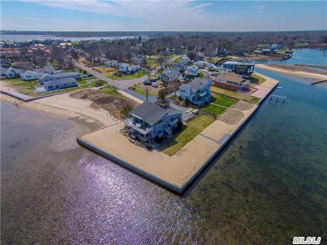 Spectacular Bay Front 3 Level Post Modern Home With Private Beach. Open Floor Plan With Eik, Dr & Gr With Vaulted Ceilings. Additional Family Room, 2 Guest Bdrm, Full Ba, & Lndy/Mud Rm. 2nd Floor Mstr Suite W/Balcony Overlooking The Bay. Private Dock With 115 Ft Of Frontage & Hot Tub. If You're Looking For A Larger Home, Permits Are In Place To Expand 2nd Level.