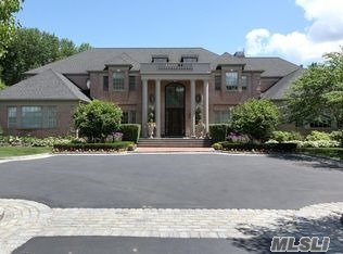 This Custom7500 Sq Ft Center Hall Colonial Is Richly Designed With Mahogany Flooring, Soaring Ceilings With Plaster Crown Moldings, And Exquisite Mill Work & Stonework Throughout.This Private Gated Residence Offers Impressive 2, 500 Sq. Ft. Basement With 10Ft Coiffured Ceiling Library, Media Rm, Wet Bar, Rec Rm And More. Privately Sited On 3 Lushly Landscaped Acres With Heated Pool.Pool House, Sports Court
