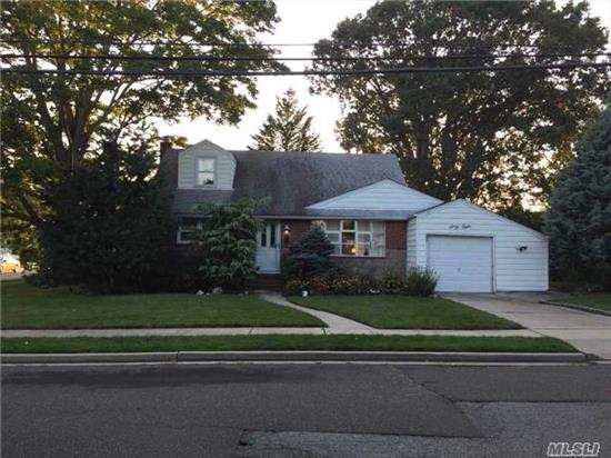 Charming, Cozy Cape Situated On A Corner Features 3 Bedrooms, 2 Full Baths, Eik, Lr/Dr , One Car Attached Garage And Private Backyard. Located Close To Highways And Shopping.  Taxes With Basic Star $9661 .