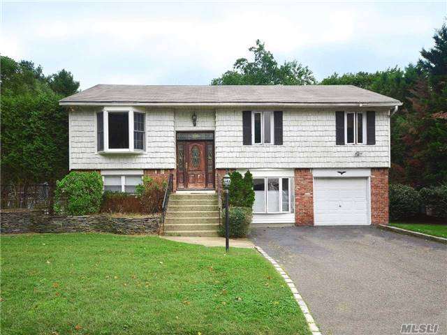 Income Potential Alert!! Fabulous 1 Family Home With Legal 2 Br Accessory Apartment. Spacious Rooms, Wood Floors Throughout, Pocket Doors, Crown Molding, 2 Sheds, 1/2 Garage For Storage, Very Private Location, Lush Property With Semi-Inground Pool & Huge Deck, Perfect For Entertaining. Harborfields Schools