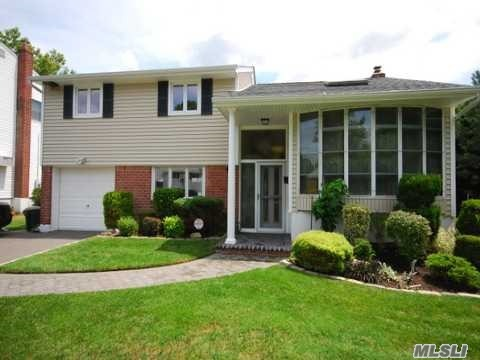 Move Right In To This Updated Mid Block Split Featering Grante Counter Top Gleeming Hard Wood Floors Open Floor Plan Private Backyard Perfect For Entertaing Too Much To List. A Must See! Close To Shopping Parkkway.