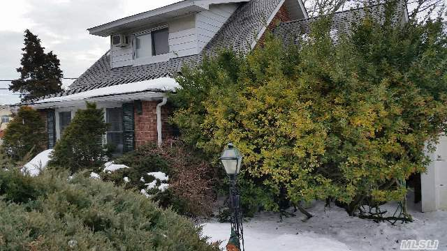 Do Not Windshield This One!  Amazing Mint Cape.  Updated Granite Kitchen With Stainless Steal Appliances.  Updated Baths,  Hardwood Floors,  Split Unit Ac On First Floor.  Custom Made Interior Shutters.  Property Lovers Delight.  Oversized Lot.