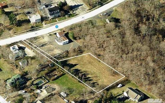 Shy 3/4 Acre Flag Lot. Cleared Level Ground. Very Private. Walk To Bay Beach. Part On Southold Hamlet Parks District. Build Your House With Best Of Both Worlds - Privacy And Access To Town Shopping, Beaches And Public Transportation.