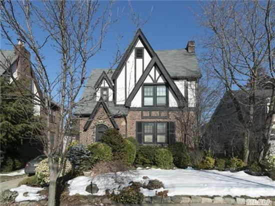 Elegant And Beautifully Appointed Brick Tudor/Colonial With Soaring 11 Foot Ceilings, Sun Drenched Formal Living Rm With Fireplace, Huge Form.Dining Rm, Kitchen With Breakfast Nook, Study, Guest Bth,  Master Suite With Updated Full Bath + 2 Large Br's, Updated Full Bath. This Home Is Perfectly Located. Walk To All