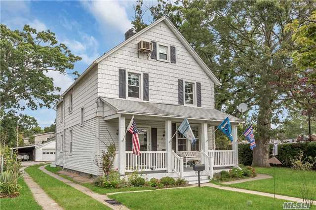 4/5 Bedroom 2 Bath Colonial With Old World Charm On 200 Ft Lot In The Heart Of Town! With Front Porch. Living Room, Office/Bedroom, Master Suite W/Wic. Updated Electric, Boiler And Chimney Liner, Replaced Windows! Refinished Floors! 7' Ceiling Finished Basement! Detached 2 Car Garage. Convenient To All! 4/10Ths Of A Mile To The Lirr!! Don't Miss Out!