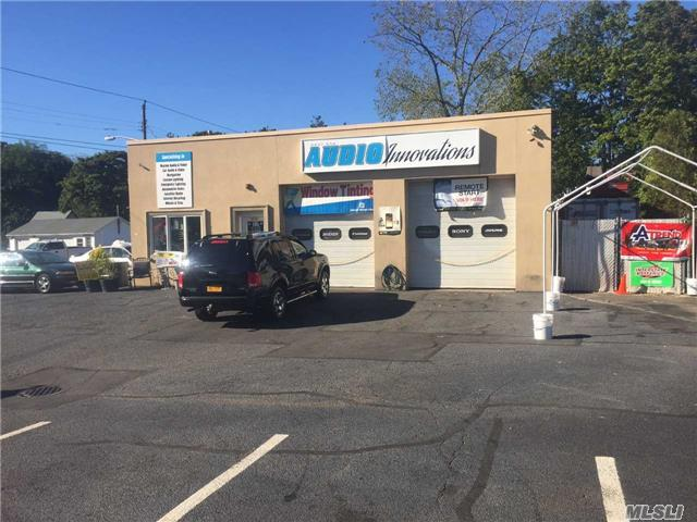 Automotive Based Building, Currently Occupied By Two Businesses.