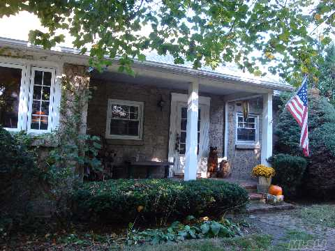 Charming Stone Cape On Large Flat Property. Low Taxes. Beautiful Enclosed Porch, Living Room, Dining Room, Eat-In-Kitchen, Full Bath, 2 Bedrooms And Bonus Room. Part Finished Basement With Bar And Ose. Working Fireplace. New Roof Down To Rafters In '04, Updated Windows. Quiet Neighborhood, Near All.