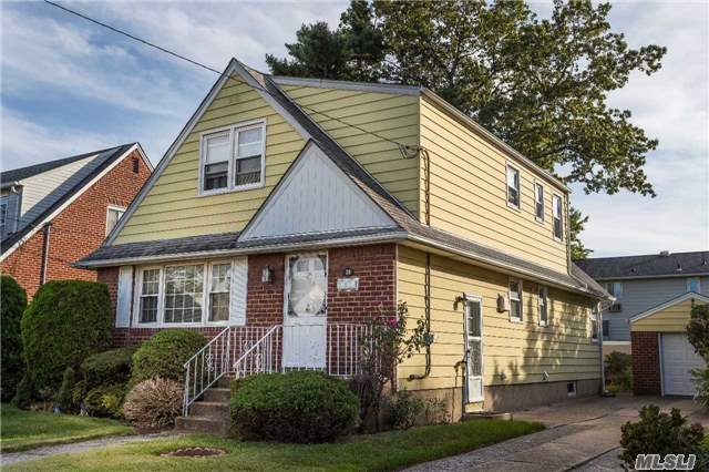 Great Cape Cod On Tree Line Street, Spacious Living Room, Beautiful Formal Dining Room, Great Eat In Kitchen, Full Finished Basement, Den/Family Room, Close To All. Great Schools, Parks, Library And More. 10 Min To Queens, 25 Min To Brooklyn, 30 Min To City (Lirr)