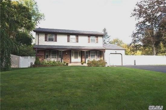 New Roof,  2 New Baths,  200 Amp Electric,  Central Air Conditioning; Wood Floors & Carpeting; Fireplace. Spacious Layout! Subpanel Generator Hook Up. Covered Front Porch & Covered Patio Overlooking Fully Flat Fenced Yard. Oversized New Driveway With Pavers.  Commuters Dream - Near Parkways. Commack Blue Ribbon Schools;  .38 Acre; $11,716.21 Real Estate Taxes with Basic Star.