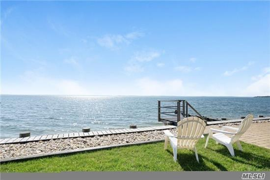 Exceptional Waterfront Cottage With Expansive Bay Views And Steps To Private Sandy Beach,  Encompassing An Open Floor Plan Throughout With Waterviews From Every Room. This Immaculate, Updated 3 Bedroom, 2 1/2 Bath Home, Including Bonus Loft, Outdoor Bath House And 2 Car Garage Has It All! Moor Your Boat Out Front Or Full Service Marina Steps Away. A True Gem!