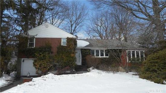 Unique 2430 Sq Ft Split On Parklike Lot (.264 Acre) At Quiet Location. Enlarged Eik,  Banquet Fdr Plus Lr Side Extension (13 X 24). Heated Rear All Seasons Room (20 X 14). Replaced Windows,  Roof @6,  Newer Gas Heat. Newer 200 Amps,  Newer Baths,  Gas Stove,  2 Sliders To 4 Seasons Rm. Lots Of Storage. Mature Landscaping. Convenient To Schools,  Shops & Lirr.
