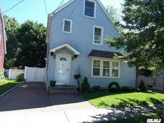 Lovely 3 Br,  2 Bath Colonial In Herricks Schools,  Large Updated Kitchen With 7 Ft Granite Island And Counters Ss Appliances Wood Flooring Throughout Propperty Fenced With Paver Patio