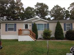 Beautiful And Spacious Large Lot And Deck Overlooking Apple Orchard. Vaulted Ceilings, Crown Molding, Skylights French Doors, Three Bedrooms, Large Master Bath, Large Closets, Carport, Storage Shed. Lot Rent $728.37 Lot Rent With Taxes     $ 928.73 Until 5/1/2019