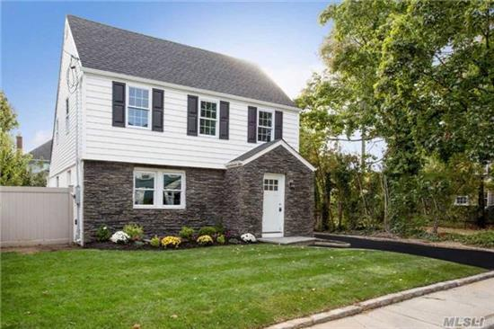Fully Renovated Colonial. Hewlett/Old Woodmere . Sd#14 Taxes 10, 554.40 W/O Star. New Plumbing And Electric Throughout The Home. New Andersen Windows, Heating, Cac, Siding, Roof, And Stone . Beautiful Wood Burning Fireplace In The Living Room. New Oakwood Floors . Long Driveway With A Garage.Landscaping With Sprinklers.Stainless Steel Appliances.High Hats. All New 2017!!