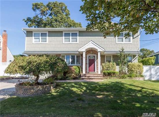Large Colonial. Custom Eik, Granite, Dbl Ovens, Wine Cooler, Breakfast Bar. Large Formal Dr For Entertaining. Kingsizemaster W/ Adjoining Br Now A Grand Walk In Closet. New Tile Bath. Hardwood Floors, Sliders To Deck. 2nd Floor: 2 Br, Bath And M/D Wing (W/Prmt)Or Amazing Master Suite. 2Br, Bath, Lr, Kit. Finished Bsmt, Lrge Priviate Yard. Mid Block. Full Tax $11, 562!