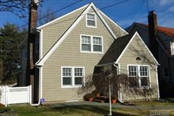 Totally Updated Colonial In The Village Of Rockville Centre. Includes-Stainless Steel Appliances, Fireplace, 2 Season Room, Hdwd Fls, Crown Moldings, Finished Basement, Walk-Up/Stand-Up Attic, Recent Siding, Roof, & Window Replacement. A Must See.