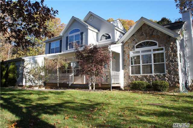 This Fabulous Home Is Situated In The Heart Of Manorville On 2.4 Plus Acres Has It All! Features Include: Lge Eik W/Ss Appl' & Breakfast Area, Hardwood Flrs, Central Air, Fam Rm W/Wood Burning Fpl, Mbr Ste W/2 Walk In Closets & Full Bath W/Double Sink, Jacuzzi Tub & Separate Shower, Full Par Finished Basement, 3 Car Garage & More.