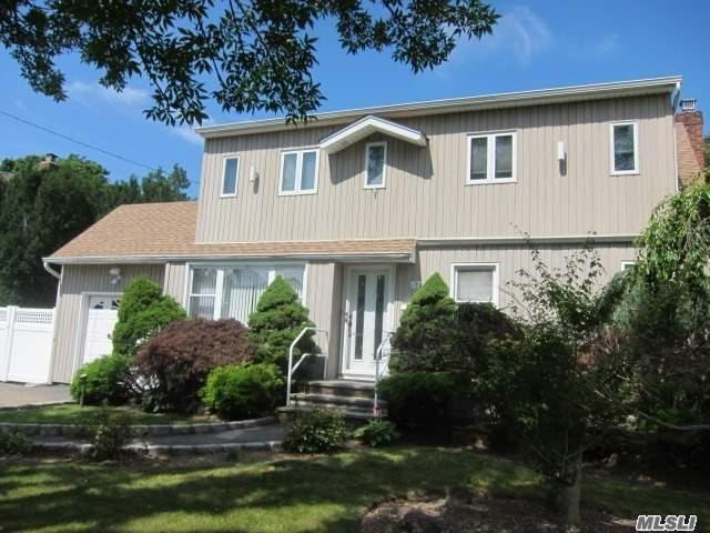 Super Colonial Sd# 23 With Updated Kitchen W/Granite Counters And Updated Baths. Hardwood Floors, Deck, Fenced Backyard. Home Located In Massapequa, No Village Tax, Massapequa Park Post Office. Great Location, Close To Parks, Shopping, And Restaurants. Start Your New Year In A New Home!