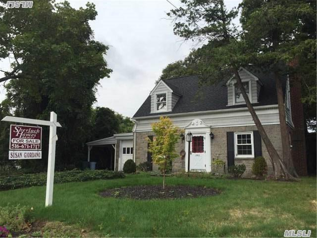 Motivated Seller! Present All Offers! Single Family Cape Cod With A Center Hall Colonial Feel! Newly Renovated Hw Floors Throughout, Beautiful Accent Detailed Moldings Throughout Featuring A Largeeat-In-Kitchen & Den All Sitting On A Lush Green Private Backyard. Borders Halls Pond, Convenient To All!