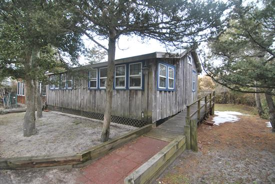 This charming house on the ocean block. Large open living area. Great deck space and large backyard.