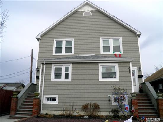 Very Desireable Side By Side 2 Family House. Each Apartment Has Its Own Entrance, Deck, Backyard And Basement. Lower Level Has Lr/Dr, Eik, Deck To Backyard, Upper Level 2Br's, Full Bath. Left Side Has .5Bath, Mud Room W/W/D. Right Side Has Small Ofc/Den & W/D In Basement. Left Side All New Kitchen/S/S Appliances, New Flooring, Windows, And Bath. Great Opportunity!