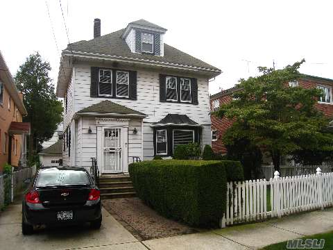 Great Opportunity, Classic Four Bedroom Colonial In A R3-1 Zone(Property Can Be Converted To A Two Family),Eat In Kitchen, Formal Living Room,Formal Dining Room,Hardwood Floors,Four Bedrooms,Two Bathrooms,Bonus Room In Attic,Full Basement, Exit To Backyard,Private Driveway With Two Car Garage,47X125 Park-Like Landscaped In The Heart Of Beautiful And Convenient Whiteston