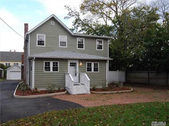 Stunning Colonial, Totally Renovated The Property, Short Walking Distance To Bay And Fire Island Ferries. New Kitchen, Baths, Roof, Siding, State Of The Art Heating System, Floors, Moldings And New Patio Being Installed, Huge Rooms Throughout The Home Including A Huge Master Bedroom Suite, Tremendous Detached Garage, Oak Railings
